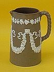 English Stoneware pitcher lion and grape appliqué