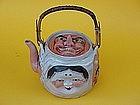 Japanese Sumidagawa pottery tea pot noh mask faces