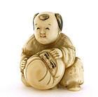 Japanese Carved Netsuke Boy Holding Daruma Figurine Sg