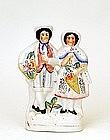 Antique English Staffordshire Boy & Girl Figurine