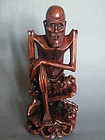 Chinese Carved Hardwood Figure of Li Tieguai, circa 1880 - 1920