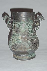 A Rare Bronze Wine Vessel with Archaic Motifs and Beast-Handles