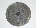 A Rare Bronze Mirror with Archaic Motifs
