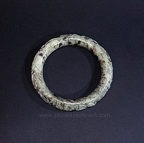 A Rare Chinese Liao or XiXia Jade Bangle with Horses - circa 1000 AC