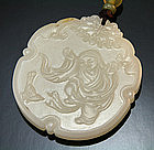 A Very Fine White Jade Pebble Plaque (PEI)