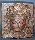 A fine wood carving depicting the Dipankara Buddha