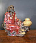 A ceramic figure of a Daoist immortal. Kanton pottery.