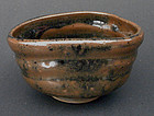 A shoe-shaped tea - chawan. Signed: So�an. Late Edo