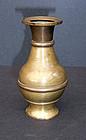 A copper vase to hold incense sticks.