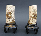 Fine pair of ivory holders. Meiji