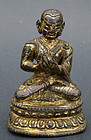 Small bronze image of a  Lama in dharmacakra-mudra