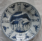 Deep dish in blue-white porcelain with a pair of deer