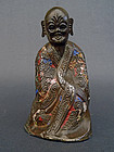A champlevé enamel copper figure of a Luohan. 19th c.