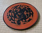 Decorative Negoro lacquer round tray. Inscribed on back