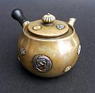 A very nice, small tea pot.By Kiyochika Koizumi
