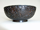 Finely carved pair of coconut bowls with silver inserts. Qing