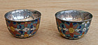 A pair of small tea cups of cloisonee inlaid with silver. Late Qing