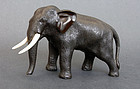 A small bronze sculpture of an elephant. Seiya. Meiji, 19th cent.