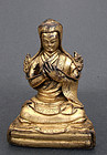 Fine gilt bronze portrait of Sakya hierarch. Tibet, 17th cent