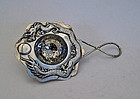 Silver tea strainer with dragon chasing pearl. SF Sing Fat