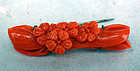 Small red coral carving as a brooch. Early 20th c.