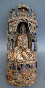 Antique wood Guanyin in her grotto on Putuo Island. Qing, 18th cent.