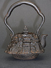 Small iron kettle / tetsubin in shape of a temple.