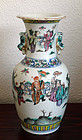 Famille rose porcelain vase with figures in a garden setting. 19th c