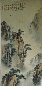 Landscape depicting retreat between steep peaks. Signed & dated 1884