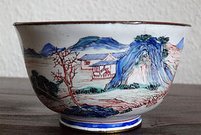 Small tea cup in Canton enamel decorated with landscape.