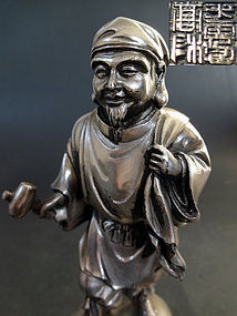 Fine silver image depicting Daikoku-ten. Takamura Koun