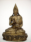 A Tibeto-Chinese  bronze figure of a Lama. Early 19th cent.