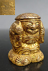 A signed, rare & fine miniature gilt bronze figure of Daikoku