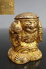 A signed, rare & fine miniature gilt bronze figure of Daikoku