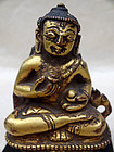 A small gilt repousse' fragment; adorned Buddha. Tibet, 15/16th c.
