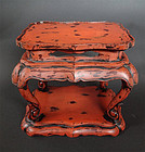 A fine negoro-lacquer stand. Edo, late 18th cent.