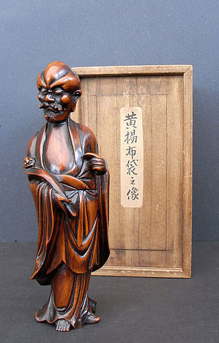 A boxwood image of a standing Luohan (huangyangmu Luohan). Qing