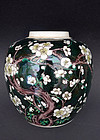 A familie noir enamel glaze jar with prunus in bloom. 19th c.