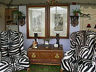 ZEBRA COWHIDE WINGBACK CHAIRS