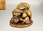 JUGYOKU (RYUKOSAI), 19TH c.  Japanese Netsuke:  Shishi and Karako