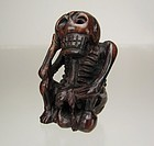19th Century. Japanese Wood Netsuke: Seated Skeleton