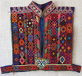 A child's vest from Afghanistan in cross stitch