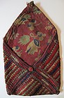 A small embroidered silk purse from Ghazni province
