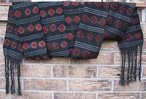 A vintage Tibetan wool sash depicting tigma motifs