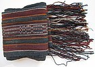 A striped woven wool sash from Tibet