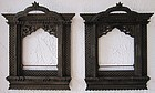A pair of hand-carved window frames from Nepal