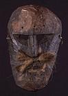 Primitive mask with mustaches, Himalaya, Nepal