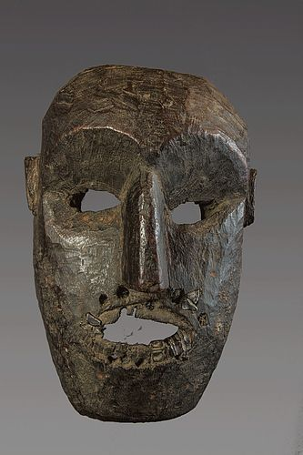 Old  mask with metal teeth, Himalaya, Nepal