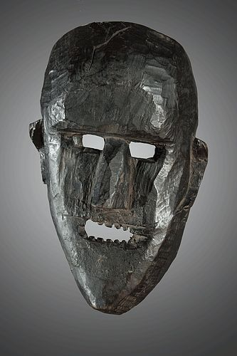 Primitive mask with a twisted face, Himalaya, Nepal