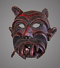 Old primitive mask of a demon, Himalaya, Nepal